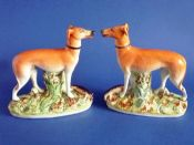 Pair of Staffordshire Pottery Standing Greyhounds with Hares c1880